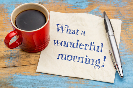 What a wonderful morning - handwriting on a napkin with a cup of coffee