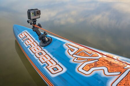 FORT COLLINS, CO - FEBRUARY 18, 2017: GoPro Hero 5 camera mounted with a suction cup on a bow of Starboard stand up paddlebord.