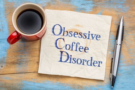 ocd: Obsessive coffee disorder (OCD) - handwriting  on a napkin with a cup of coffee