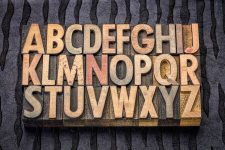 black block: alphabet in vintage letterpress wood type printing blocks against black lokta paper