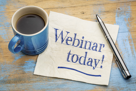 webinar today reminder - handwriting on a napkin with cup of espresso coffee