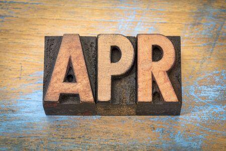letterpress type: Apr - April month abbreviation in vintage letterpress wood type against grunge wooden background