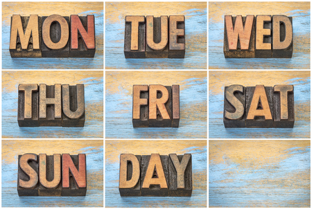 a set of days of week (abbreviations) in vintage letterpress wood type against grunge wooden background Stock Photo
