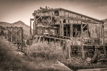 ruins of gold mine  (processing mill) near Mosquito Pass in Rocky Mountains, Colorado, sepia toning