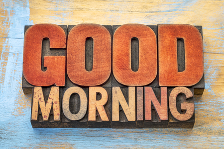 letterpress type: Good Morning - word abstract in vintage letterpress wood type blocks against grunge wooden background
