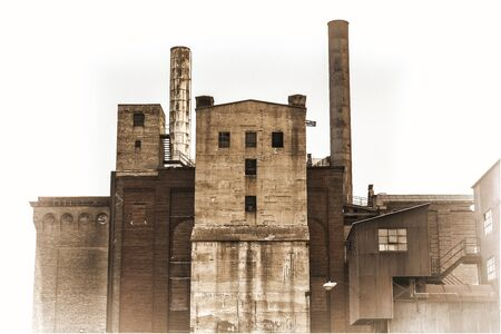 old power plant building with brick, concrete and metal walls, retro sepia toning