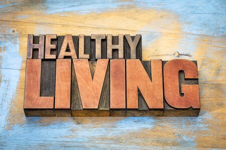 letterpress type: healthy living banner in vintage letterpress wood type blocks stained by color inks