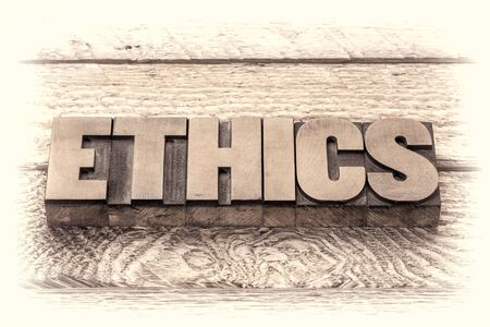 ethics word in vintage letterpress wood type, retro sepia toning