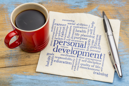 personal development word cloud - handwriting on a napkin with a cup of coffee