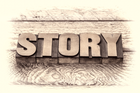 narration: story word in vintage letterpress wood type, sepia toning