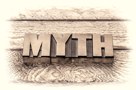narration: myth word in vintage letterpress wood type, sepia toning