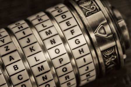 secret code: blog word as a password to combination puzzle box with rings of letters, sepia toned Stock Photo