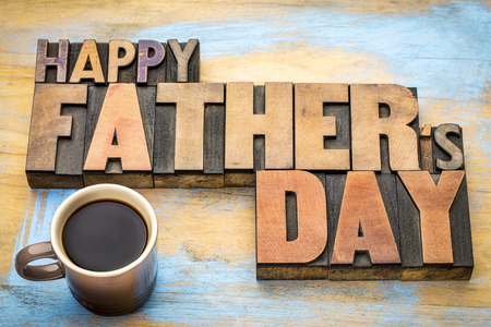 paternal: happy fathers day greeting card in vintage letterpress wood type printing blocks with a cup of coffee