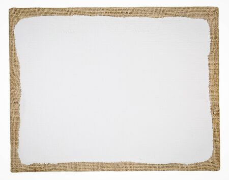 primed and stretched burlap art canvas isolated on white Stock Photo