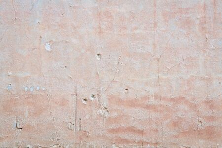 old plaster wall background and texture with holes and cracks