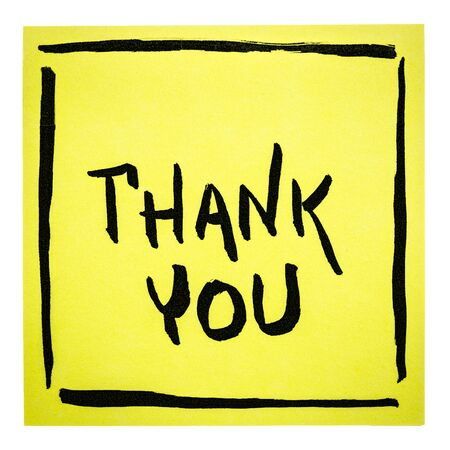 Thank you  - handwriting on an isolated yellow sticky note