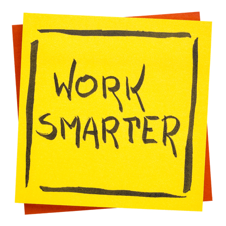 work smarter inspirational advice or reminder - handwriting on an isolated sticky note Imagens