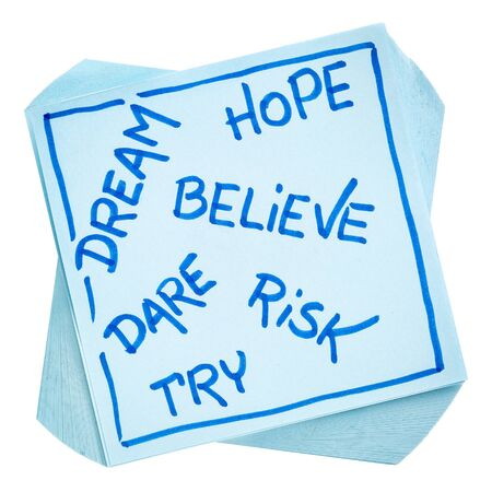 dream, hope, believe, dare, risk, and try - motivational concept - hnadwriting on an isolated sticky note Stock Photo