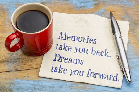 Memories take you back, dreams  take you forward - inspirational handwriting on a napkin with a cup of coffee