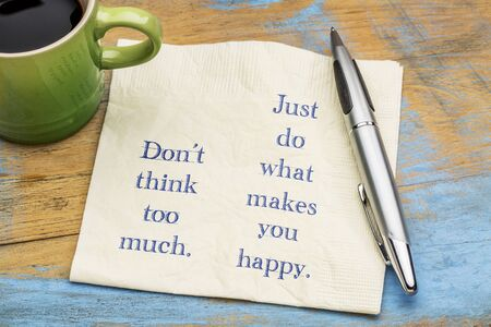 Do not think too much. Just do what makes you happy. Inspirational handwriting on a napkin with a cup of coffee. Banco de Imagens - 79377105