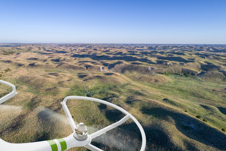 nebraska: aerial view of Nebraska Sand Hills near Thedford, spring scenery with rotating drone propellers Stock Photo