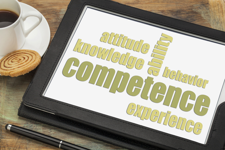 competence concept  - word abstract on a digital tablet with a cup of espresso coffee