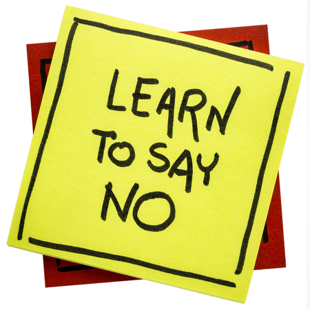 Learn to say no  advice or reminder - handwriting on an isolated sticky note