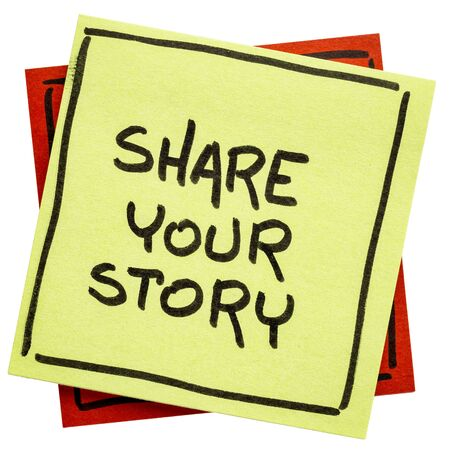 share your story reminder  - handwriting on an isolated sticky note