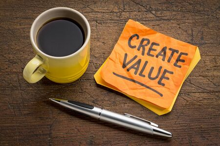 create value reminder or advice - inspiration concept - handwriting on a sticky note with a cup of coffee