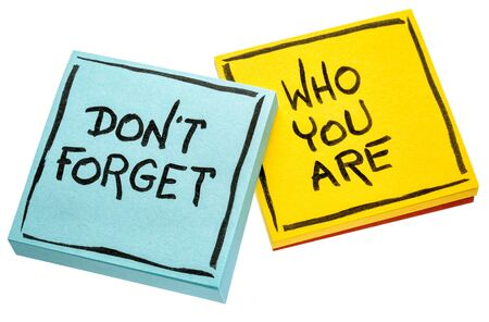 Do not forget who you are - handwriting on isolated sticky notes Banco de Imagens