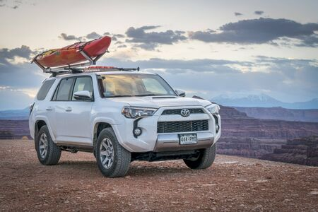moab: POTASH , UT, USA - MAY 7, 2017:  Toyota 4runner SUV (2016 trail edition) with a whitewater kayak on roof racks in the Colorado RIver canyoin near Moab. Editorial