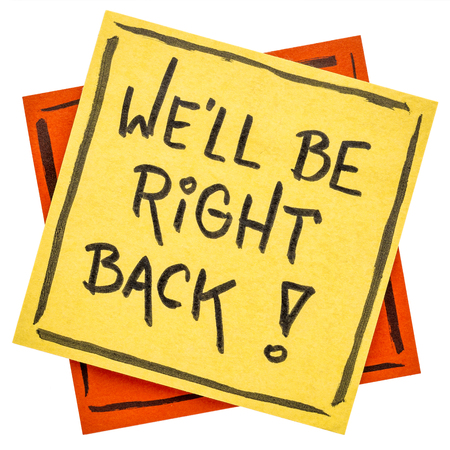 We will be right back - handwriting on an isolated sticky note