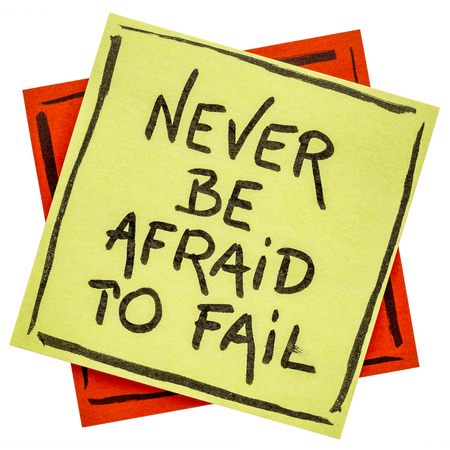 Never be afraid to fail reminder - handwriting on an isolated sticky note