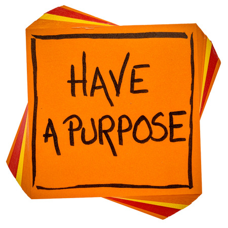 Have a purpose reminder or advice  - handwriting on an isolated sticky note Stock Photo
