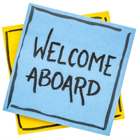 Welcome aboard  - handwriting on an isolated sticky note Stok Fotoğraf