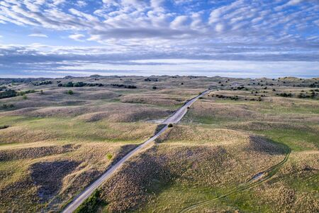 aerial view of sandy road in Nebraska Sandhills near Seneca, spring scenery with morning light 免版税图像