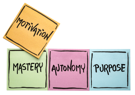 three elements of true motivation - mastery, autonomy, purpose - - handwriting in black ink on isolated sticky notes Stock Photo