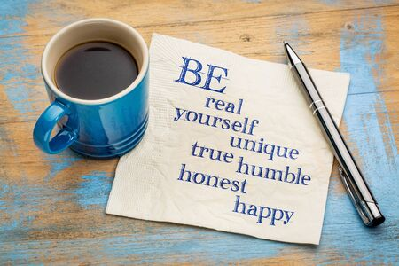 advice: Be real, yourself, unique, true, humble, honest and happy - inspirational handwriting on a napkin with a cup of espresso coffee Stock Photo