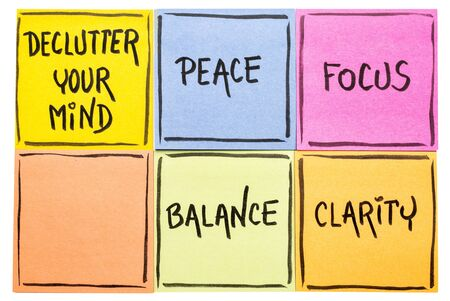 Declutter your mind for clarity, peace, focus and balance - handwriting on an isolated set of sticky notes Фото со стока