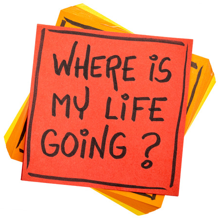 Where is my life going? An essential question or searching for purpose  - handwriting on an isolated sticky note