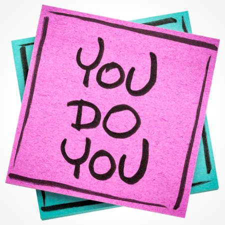 you do you, being yourself concept - handwriting on a sticky note isolated on white
