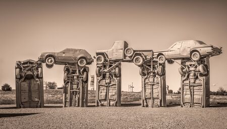 ALLIANCE, NE, USA - MAY 29, 2017:  Carhenge - famous car sculpture  created by Jim Reinders, a modern replica of  Englands Stonehenge using old cars., sepia toned image