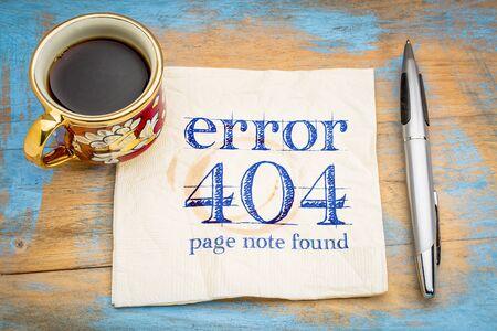 Fout 404 - webpagina niet gevonden teken-handschrift op een servet met een kopje koffie