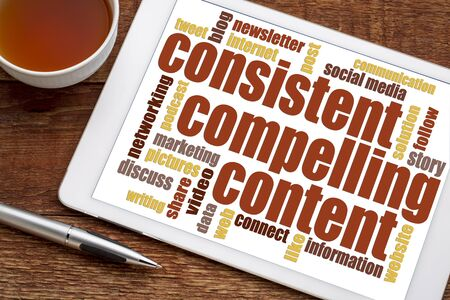 consistent, compelling content -  recommendation for bloging and social media marketing - a word cloud on a digital tablet with a cup of tea Stock Photo