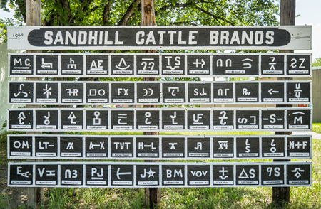 sandhills: MERRIMAN, NE, USA - July 9, 2017:  Sandhill Cattle Brands 1964, a collection of brands with ranch owners names in a small village of Merriman in Nebraska Sandhills.