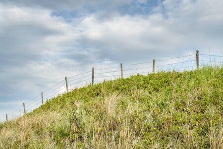 barbed wire fence in Nebraska Sandhills, summer scenery