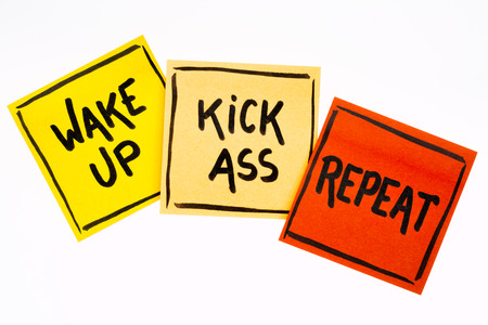 wake up, kick ass, repeat reminder or advice, handwriting on isolated sticky notes Stock Photo