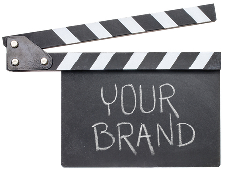 your brand movie title - text in white chalk on clapboard isolated on white Banco de Imagens
