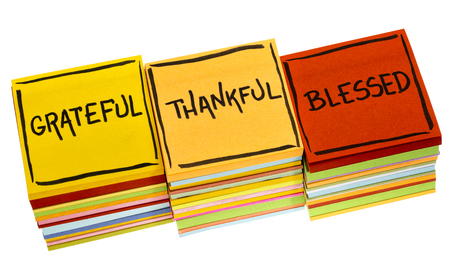 Grateful, thankful, blessed  spiritual words - handwriting in black ink on an isolated sticky note