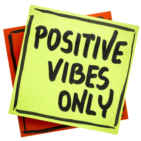 vibe: Positive vibes only advice or reminder - handwriting on an isolated sticky note